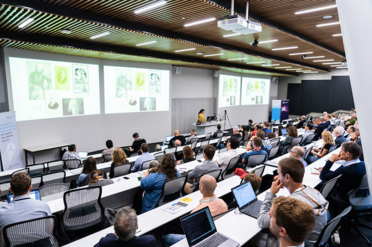 Group of conference attendees in a lecture theatre during the keynote presentation